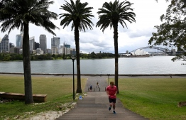 Residents are out for exercise along the Sydney Harbour on September 13, 2021 after some relaxations in the pandamic restrictions by the New South Wales state. -- Photo: Saeed Khan/ AFP