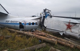 This handout picture taken and released on October 10, 2021 by the Russia's Emergencies Ministry shows a wreckage at a site of the L-410 plane crash near the town of Menzelinsk in the Republic of Tatarstan. -- Photo: Russian Emergency Ministry/ AFP
